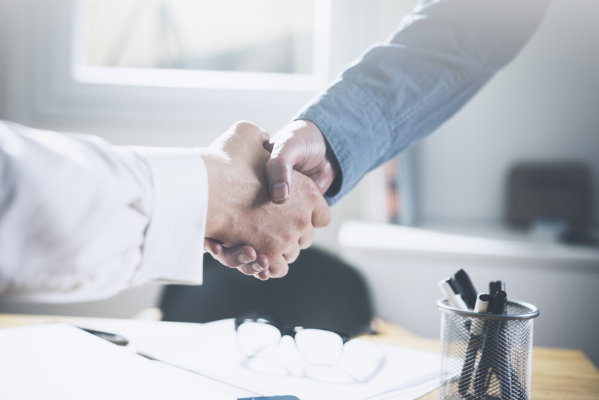 Close up image of business partners making handshake
